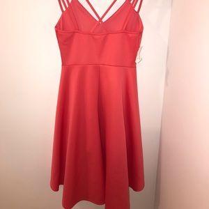 Pink skater dress with fancy back